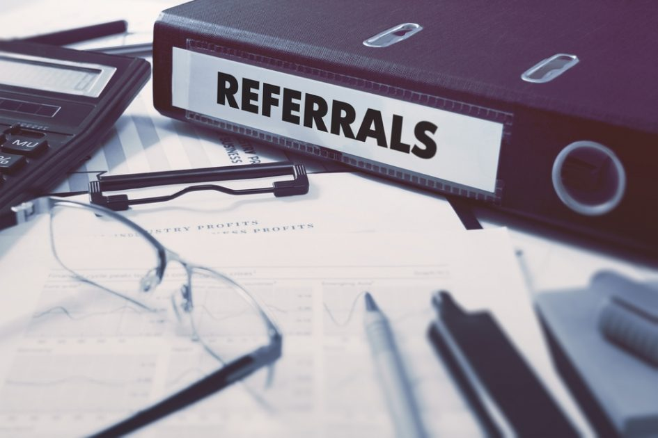 referrals ring binder on office desktop with office supplies. business concept on blurred background. toned illustration - Cómo encontrar proveedores para tu evento